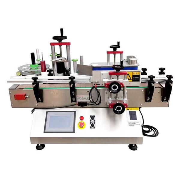 Automatický stroj na označování lahví na stole