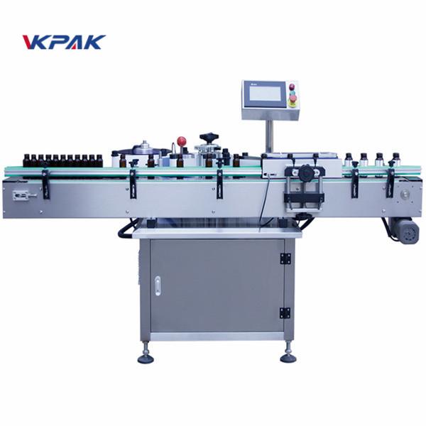 Automatický etiketovací stroj s vertikální kulatou lahví